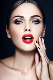 Sensual glamour portrait of beautiful  woman model lady with red lips color and clean healthy skin face