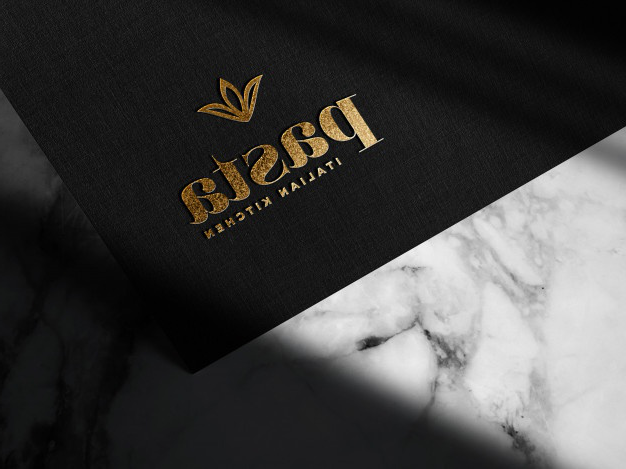Luxury embossed gold logo mockup on black paper