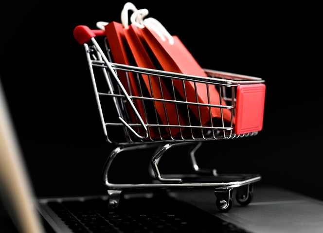 Front view of cyber monday shopping cart with bags